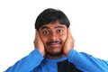 Free Indian Male Showing Distress By Covering His Ears Stock Image - 23680741