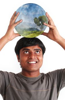 Free Young Man Smiling And Holding Ball With Ecosystem Stock Photography - 23698422