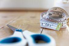 Tape Measure And Scissors Stock Image