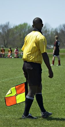 Soccer Linesman With Flag Royalty Free Stock Image