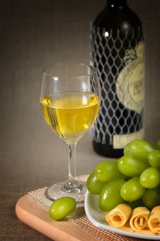 Free A Glass Of White Wine, Green Grapes And A Bottle O Stock Photo - 23707230