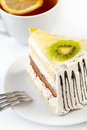 Free A Cup Of Tea And A Piece Of Tasty Creamy Cake Stock Photography - 23711222
