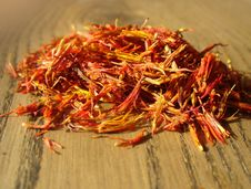 Free Pile Of Saffron On Wooden Background Royalty Free Stock Images - 23710549
