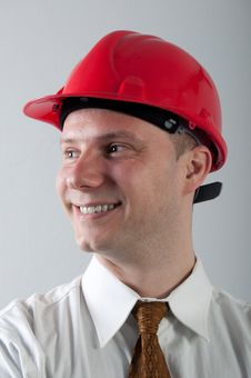 Portrait Of Young Smiling Engineer With Red Helmet Stock Images