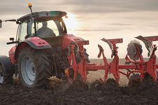 Free Tractor Plowing In Sunset Stock Images - 23742214
