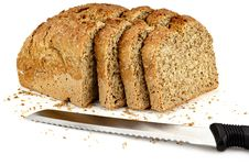 Free A Loaf Of Bread With A Three Slices And A Knife Stock Photo - 23747660
