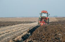 Free Tractor Plowing Royalty Free Stock Photography - 23755087