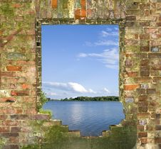Window In A Brick Wall With A Kind On The River Royalty Free Stock Images