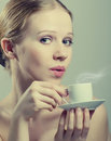 Free Beautiful Girl Enjoying  Cup Of Coffee Royalty Free Stock Images - 23767839