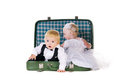 Free Boy And A Girl Sitting In A Suitcase Stock Photo - 23769070