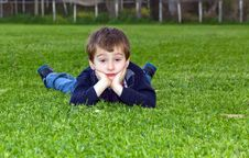 Free Cute Child Lying On Grass Royalty Free Stock Images - 23762839