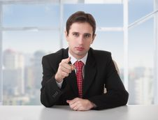 Free Successful Businessman Seriously Sitting At Desk Stock Photography - 23767872
