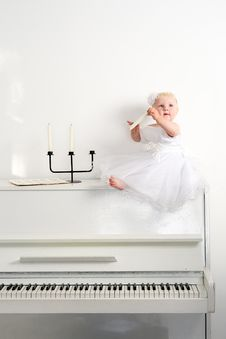 Free Girl On A White Piano Stock Photography - 23769132
