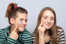 Free Teenage Girls Showing Hearts On Their Faces Stock Images - 23772424