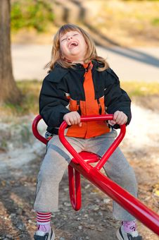 Free Cute Little Girl Having Fun On The Playground Stock Photography - 23778932