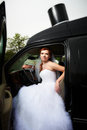Free Beauty Bride Into Big Black Car Royalty Free Stock Image - 23780656