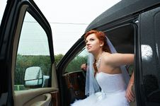 Free Beauty Bride Into Big Car Royalty Free Stock Photography - 23780637