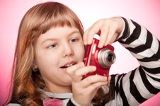 Free Girl With A Camera Royalty Free Stock Photos - 23783858