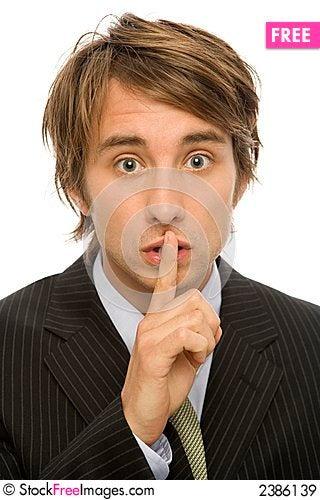 Businessman wispers Stock Photo