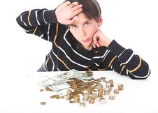Free Boy Considers Money Royalty Free Stock Photo - 2388315