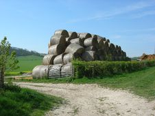 Free Stacked Rolls Of Hay In Field Stock Images - 2389784