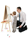 Free Businessman Teaches His Son To Paint On An Easel Royalty Free Stock Image - 23823716