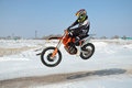 Free Motocross Driver Flies Over Hill Out Of Snow Stock Images - 23824674