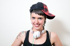 Free Cute Young Woman With Headphones And Cap Stock Photo - 23824800