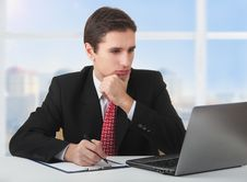 Free Successful Businessman Working Behind Notebook Stock Photography - 23826212