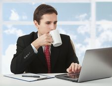 Free Successful Businessman Working Behind Notebook Stock Image - 23826221
