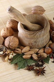Wooden Mortar And Pestle With Spices And Nuts