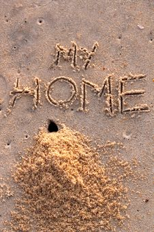 Crab Hole And A Pile Of Sand With Words My Home Stock Images
