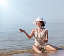 Woman In White Hat Posing Against The Sea Stock Photo
