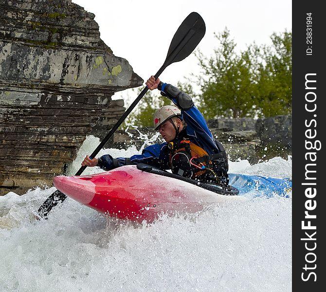 Kayaker in the waterfall
