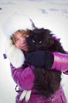 Free Kid Girl Holding Black Cat Royalty Free Stock Photography - 23849277