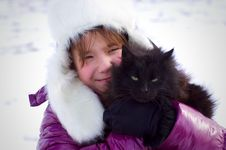 Free Kid Girl Holding Black Cat And Smiling Royalty Free Stock Photos - 23849278