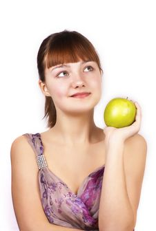 Free Looking Up Pretty Woman With Green Apple Isolated Stock Photo - 23869550