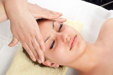 Beautiful Young Women Getting A Face Massage Royalty Free Stock Image