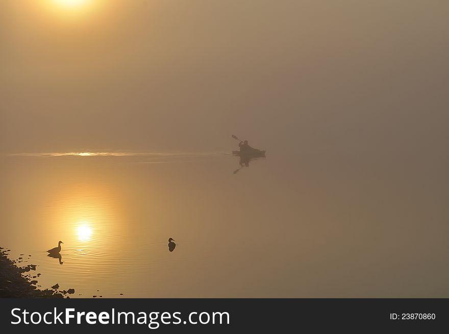 Kayak on foggy morning