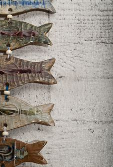 Free Half Fish Body Pottery On Wooden Board Stock Photos - 23882263
