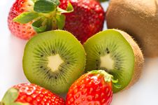 Kiwi And Strawberry On White Background Stock Images