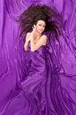 Free Girl With Long Dark Hair Of Purple Silk Royalty Free Stock Image - 23893926