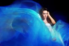 Free Girl In The Blue Dress From Flying Fabric Stock Photos - 23893943