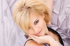 Portrait Of A Beautiful Blonde In A Gray Silk Royalty Free Stock Photos