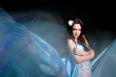 Girl In The Blue Dress From Flying Fabric Royalty Free Stock Photography
