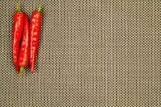 Free Three Red Hot Peppers On A Beige Background Stock Photo - 23894350