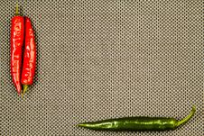 Free Red And Green Hot Pepper On A Beige Background Stock Photo - 23894410