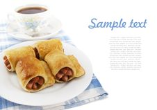 Sausage In The Dough On A Plate And Cup Of Tea Stock Photography