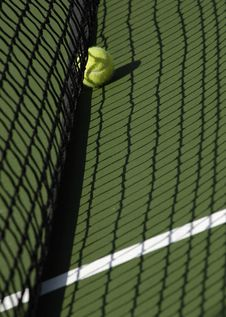 Free Tennis Ball On Court In Shadow Royalty Free Stock Photo - 2393145