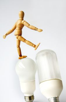 Free Mannequin On Lightbulb Stock Photography - 2393552